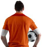Football player in orange holding ball Royalty Free Stock Photography