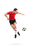 Football player performing a rainbow flick Royalty Free Stock Photo