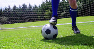 Football player playing with soccer ball in the field stock video