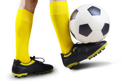 Football player playing a soccer ball Royalty Free Stock Images