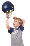 Football player. Portrait of a young boy with a football helmet on white background Royalty Free Stock Image