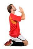 Football player praying Royalty Free Stock Photo