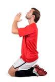 Football player praying Stock Photo