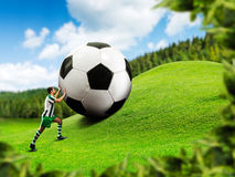 Football-player pushing a ball Royalty Free Stock Photography