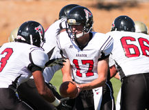 Football Player Quarterback Handing The Ball During A Game Royalty Free Stock Photos