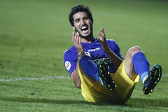 Football player reaction. Football player (Younes Hamza) reaction after missing a chance of goal in the match between Petrolul Ploiesti and Ceahlaul Piatra Neamt Royalty Free Stock Images