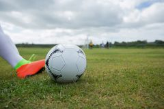 Football player ready to kick the soccer ball. In the ground Stock Photo