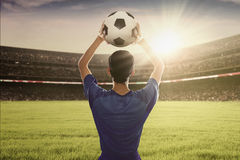 Football player ready to throw a ball Royalty Free Stock Photography