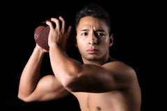 Football player ready to throw the ball Royalty Free Stock Image