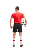 Football player in red jersey holding a ball Royalty Free Stock Images
