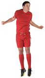 Football player in red jumping Royalty Free Stock Photos