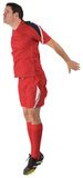 Football player in red jumping. On white background Stock Photos