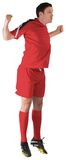 Football player in red jumping Royalty Free Stock Photography