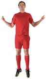 Football player in red jumping Royalty Free Stock Image