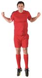 Football player in red jumping Royalty Free Stock Photo
