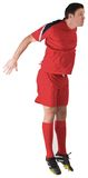 Football player in red jumping Royalty Free Stock Images