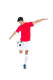 Football player in red kicking ball Royalty Free Stock Photo