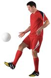 Football player in red kicking Royalty Free Stock Photography