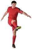 Football player in red kicking Royalty Free Stock Images