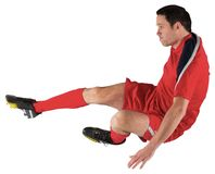Football player in red kicking Stock Photo