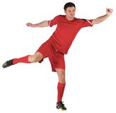 Football player in red kicking Stock Image