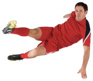 Football player in red kicking Royalty Free Stock Photo