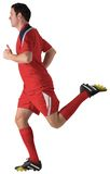 Football player in red running. On white background Royalty Free Stock Photos