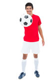 Football player in red showing ball Stock Photography