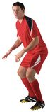 Football player in red standing ready Stock Photos