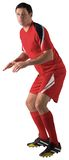 Football player in red standing ready Royalty Free Stock Photography