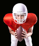 Football Player on red uniform on black background.  Stock Photos