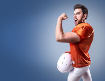 Football Player on red uniform on blue background Stock Photography
