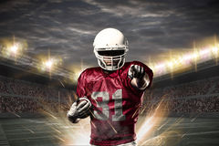 Football Player. On a Red uniform celebrating on a Stadium royalty free stock images