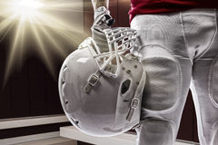 Football Player. With a red uniform on a Locker roon Stock Photography