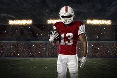 Football Player. With a red uniform on a stadium Stock Photos