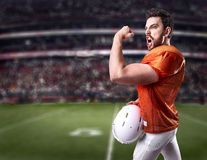 Football Player on red uniform in the stadium Royalty Free Stock Image