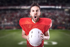 Football Player on red uniform in the stadium Stock Image