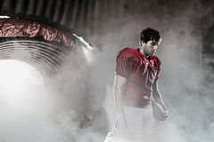 Football player. With a red uniform, in a stadium with fans wearing red uniform Royalty Free Stock Photo