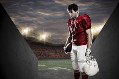 Football Player. With a red uniform on a tunnel to a stadium Stock Photos