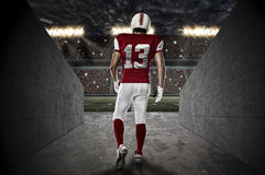 Football Player. With a red uniform walking out of a Stadium tunnel Royalty Free Stock Image
