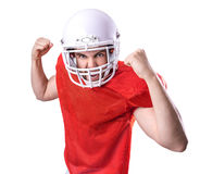 Football Player on red uniform on white background Stock Images