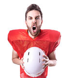 Football Player on red uniform on white background Royalty Free Stock Photography
