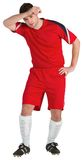 Football player in red wiping his brow. On white background Stock Images