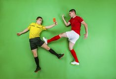 Football player and referee Royalty Free Stock Photo