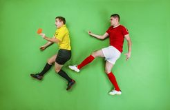 Football player and referee Royalty Free Stock Photos
