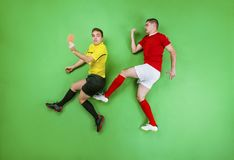 Football player and referee Royalty Free Stock Images