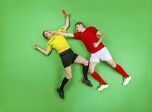 Football player and referee Royalty Free Stock Image