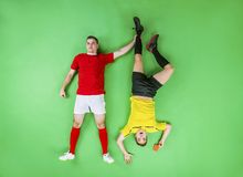 Football player and referee Stock Photo