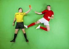 Football player and referee Stock Photography