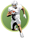 Football player running with the ball Royalty Free Stock Photography